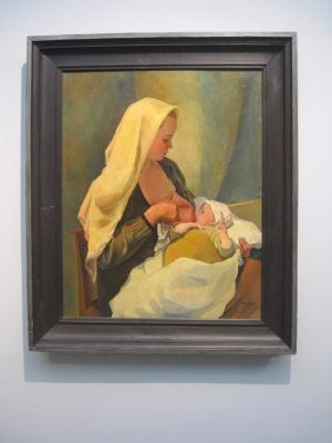 Maalaus Mariasta syöttämässä Jeesusta.
