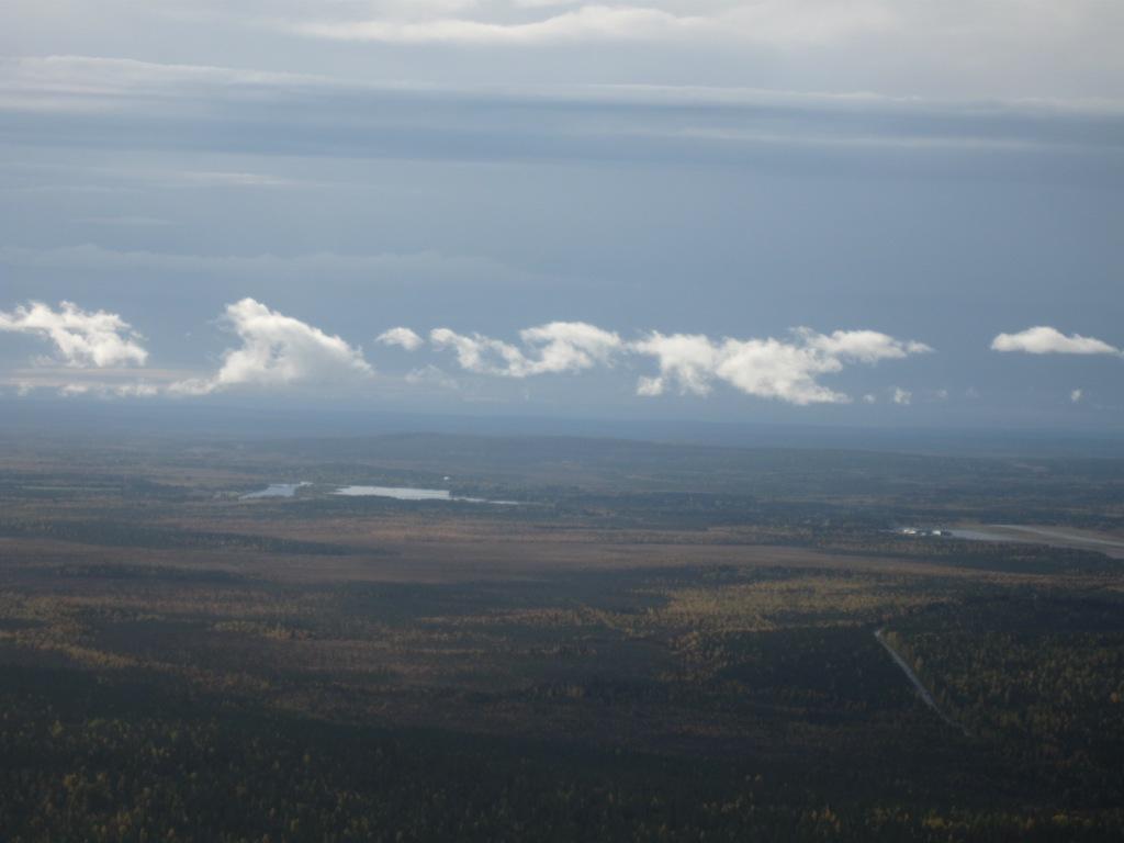 Taivas ja maa ylhäältä päin kuvattuna.